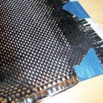 Fig. 2 - Tessuto di fibra di carbonio direzionale, preimpregnata da resina epossidica